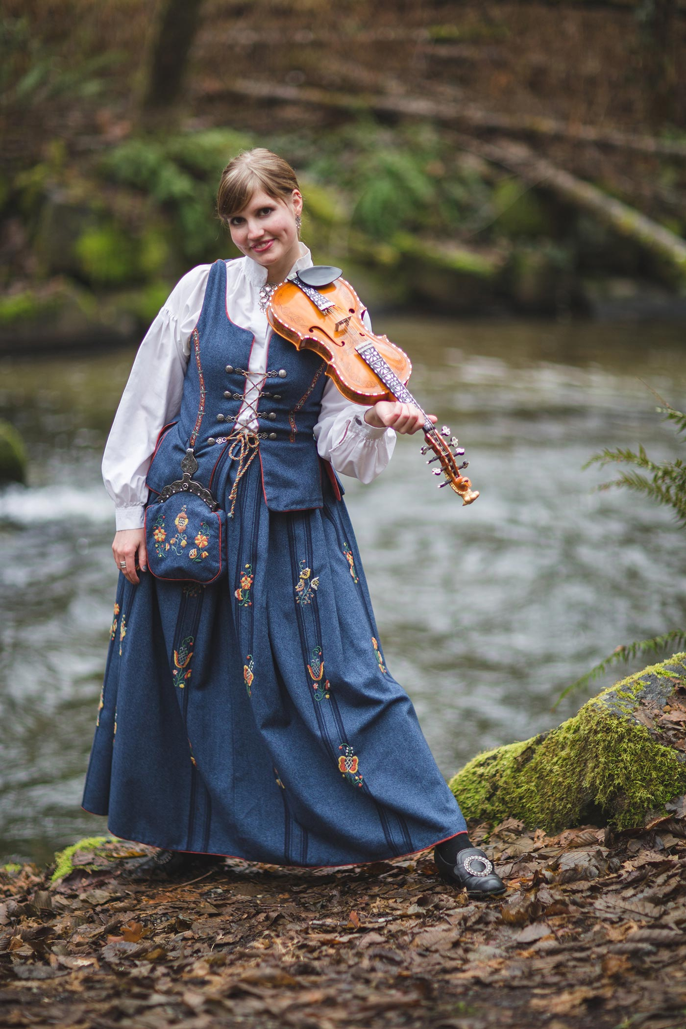 Rachel Nesvig in traditional bunad by a river
