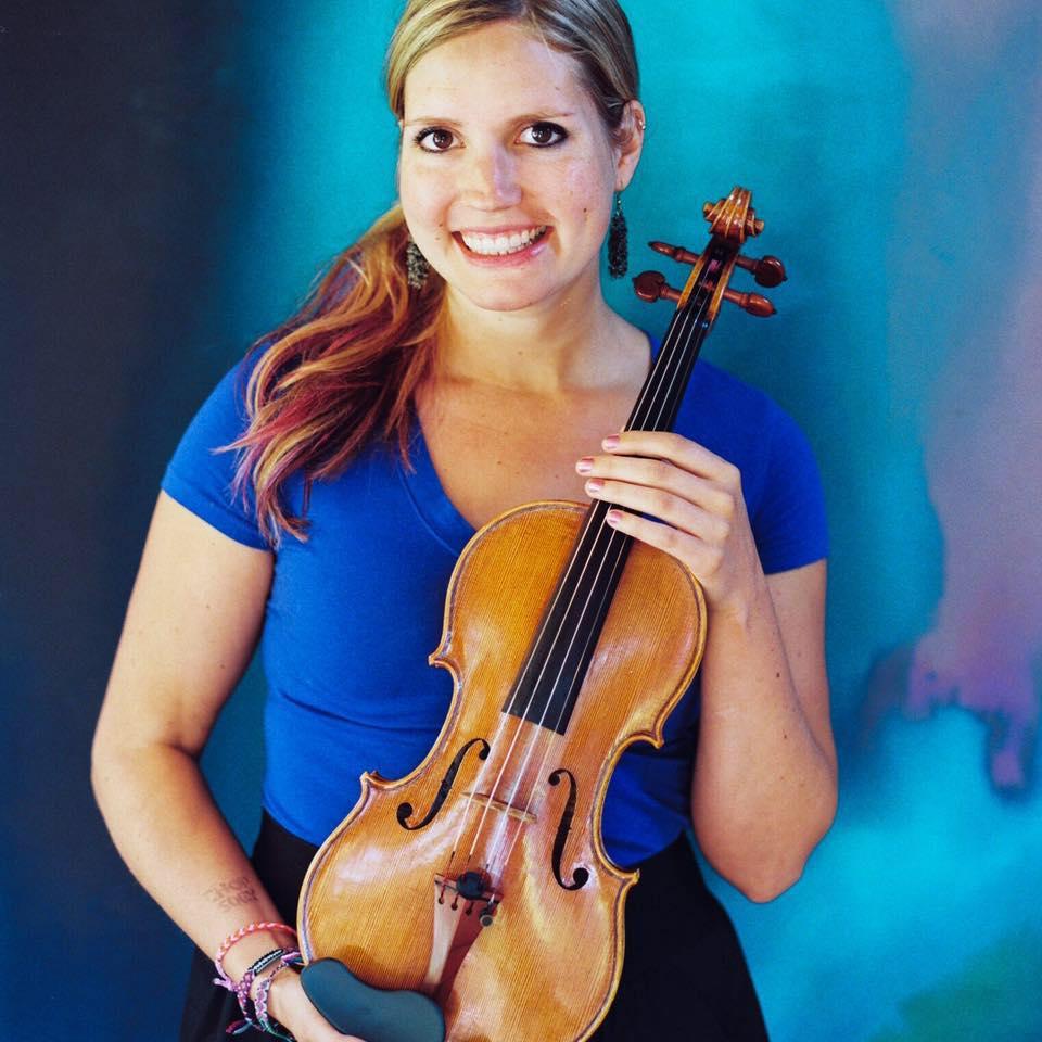 Rachel Nesvig holding a violin