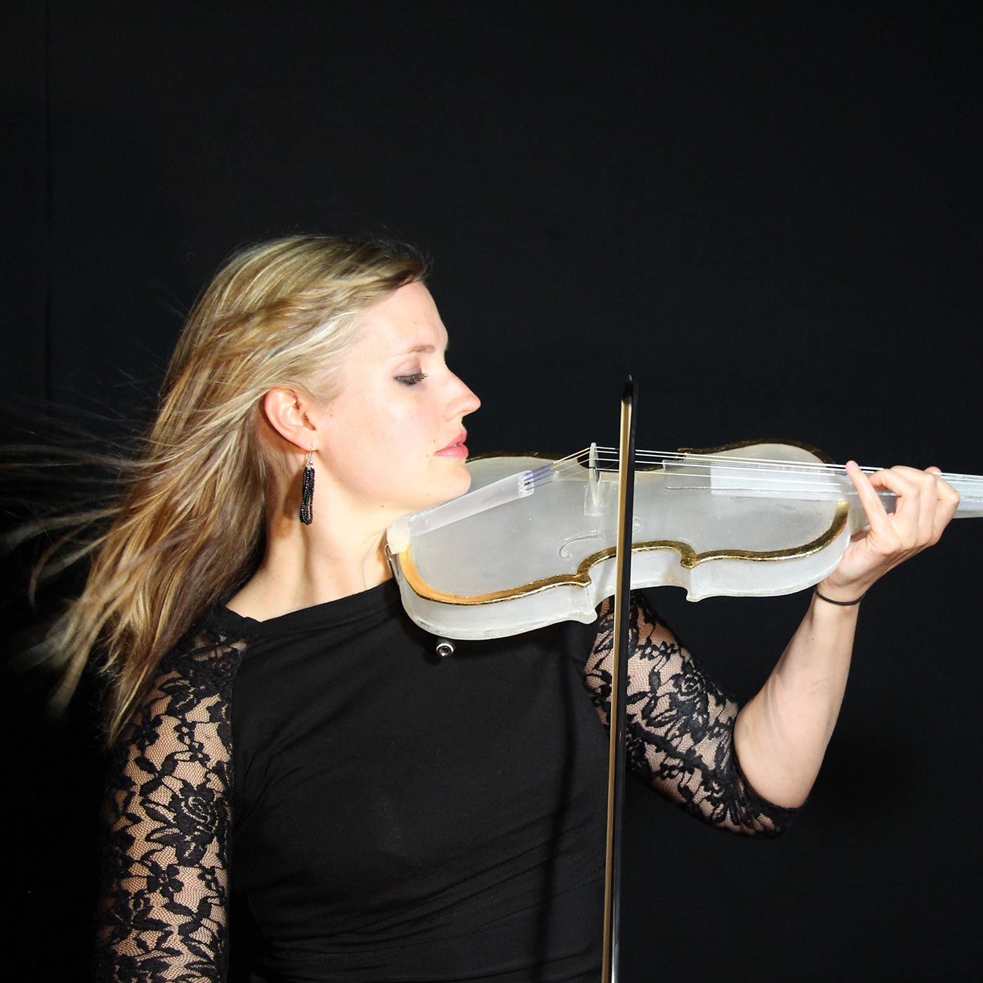 Rachel playing a white glass violin